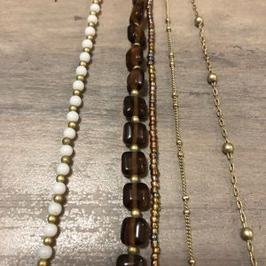 Multi strand brown and gold necklace